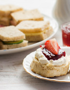 Includes traditional filled sandwiches, large plain scone filled with strawberry preserve and butter, mini afternoon cake selection and freshly brewed coffee or tea.